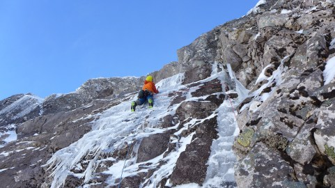 "Nick dealing with some fairly thin and ""steeper than it looks"" ice on the crux"