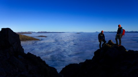 Kev and Max near Crowberry Tower above a sea of cloud and little Munro islands!