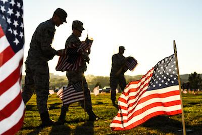 Team Hill Airmen carry flag bundles during a flag-placing detail, Utah Veterans Memorial Cemetery, Bluffdale, Utah, Nov. 10, 2016. (U.S. Air Force photo by R. Nial Bradshaw)
