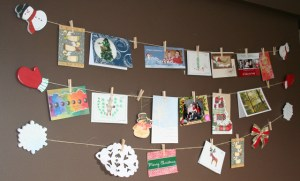 Christmas cards hanging on a string on the wall