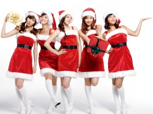 Sexy Santa girls in Christmas costume with presents