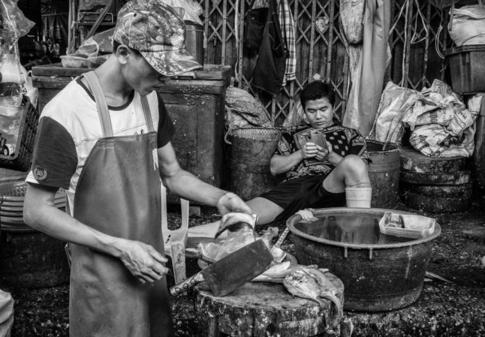 Fishmongers at Khlong Thoey Market, Bangkok