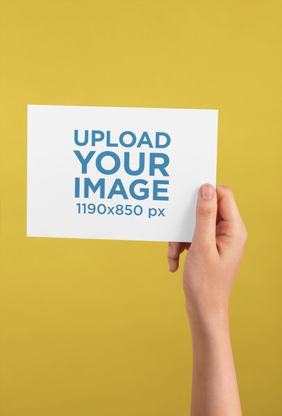 placeit horizontal postcard mockup being held against a color
