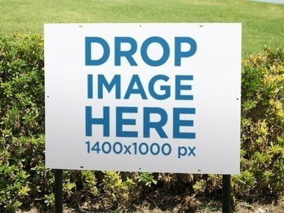 placeit real estate lawn sign mockup on a garden