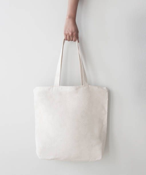 blank canvas tote bag design mockup with hand handmade shopping bags