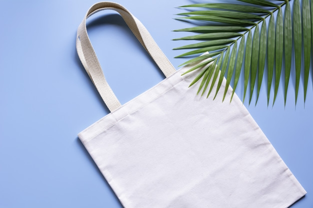 white tote bag canvas fabric cloth shopping sack mockup with copy