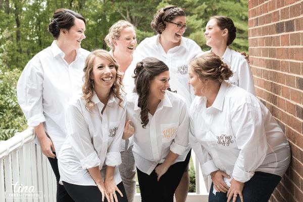 getting-ready-bridesmaids-monogrammed-shirts-collared-girlfriends-laughing-fun-happy-girls-bride-Richmond-virginia-wedding-photographer-tina-take-my-photo-fall-celebrations-reservoir-midlothian