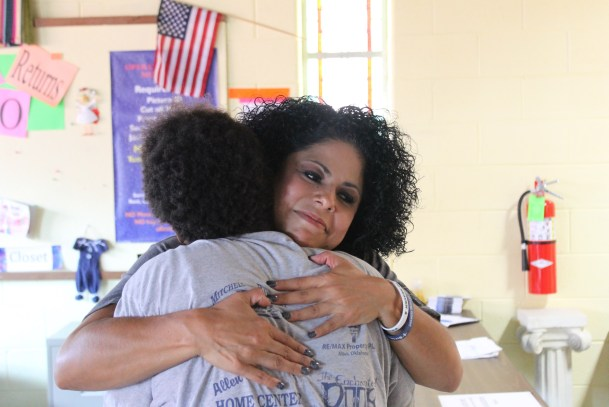 Anita receives a tight embrace from Angela Ybarra, Director of Operation C.A.R.E.