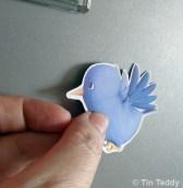 A fridge magnet - Tin Teddy Twittert Bird printed on magnet sheet
