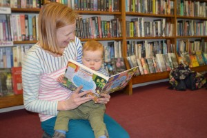 Baby reading at Tiny Tales