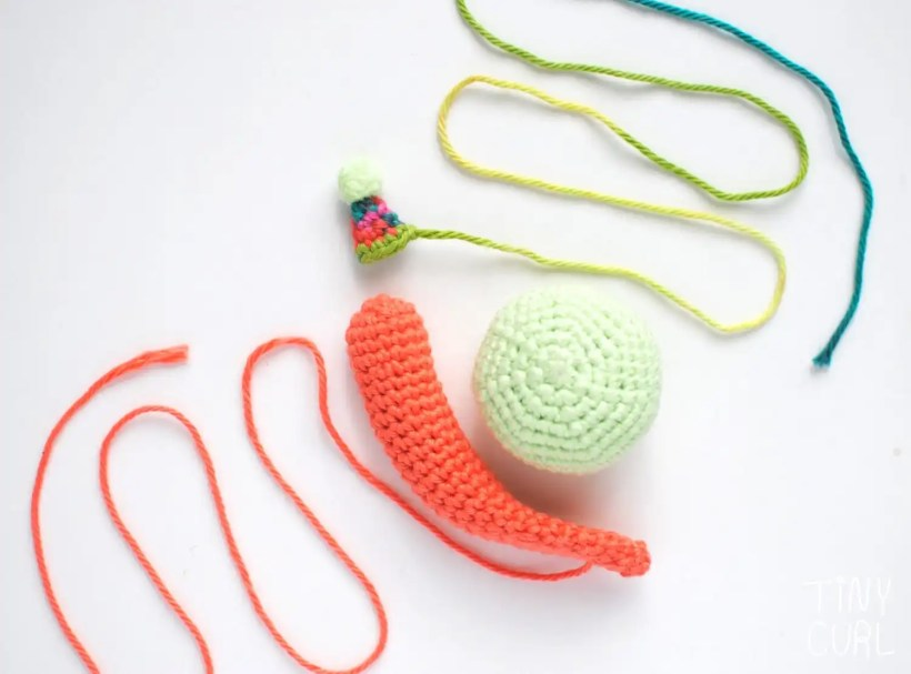 The three pieces of the amigurumi Party Snail before being attached together.