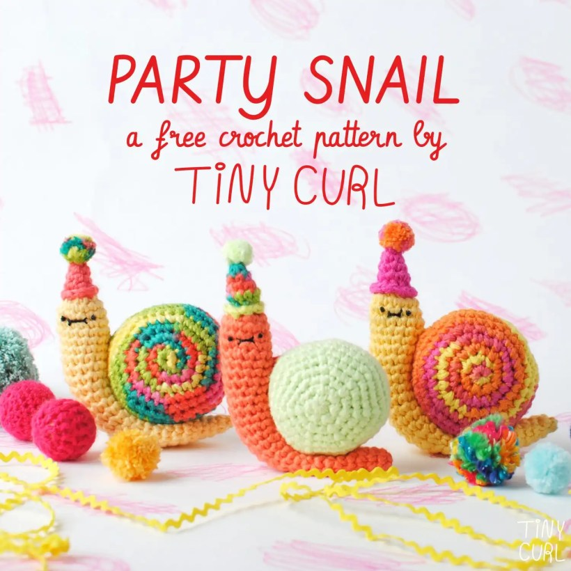 Three Party Snail amigurumi dolls at a yarn party. These were made with the free amigurumi pattern from Tiny Curl.