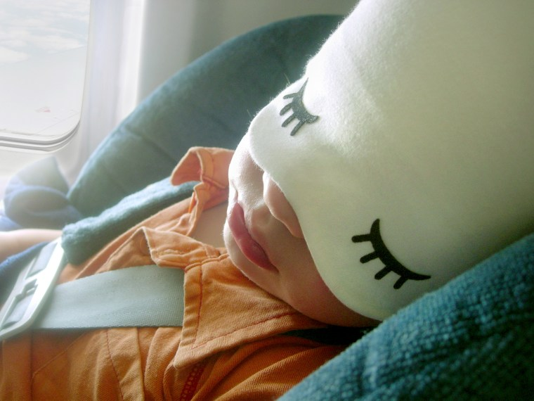Baby sleeping on an airplane