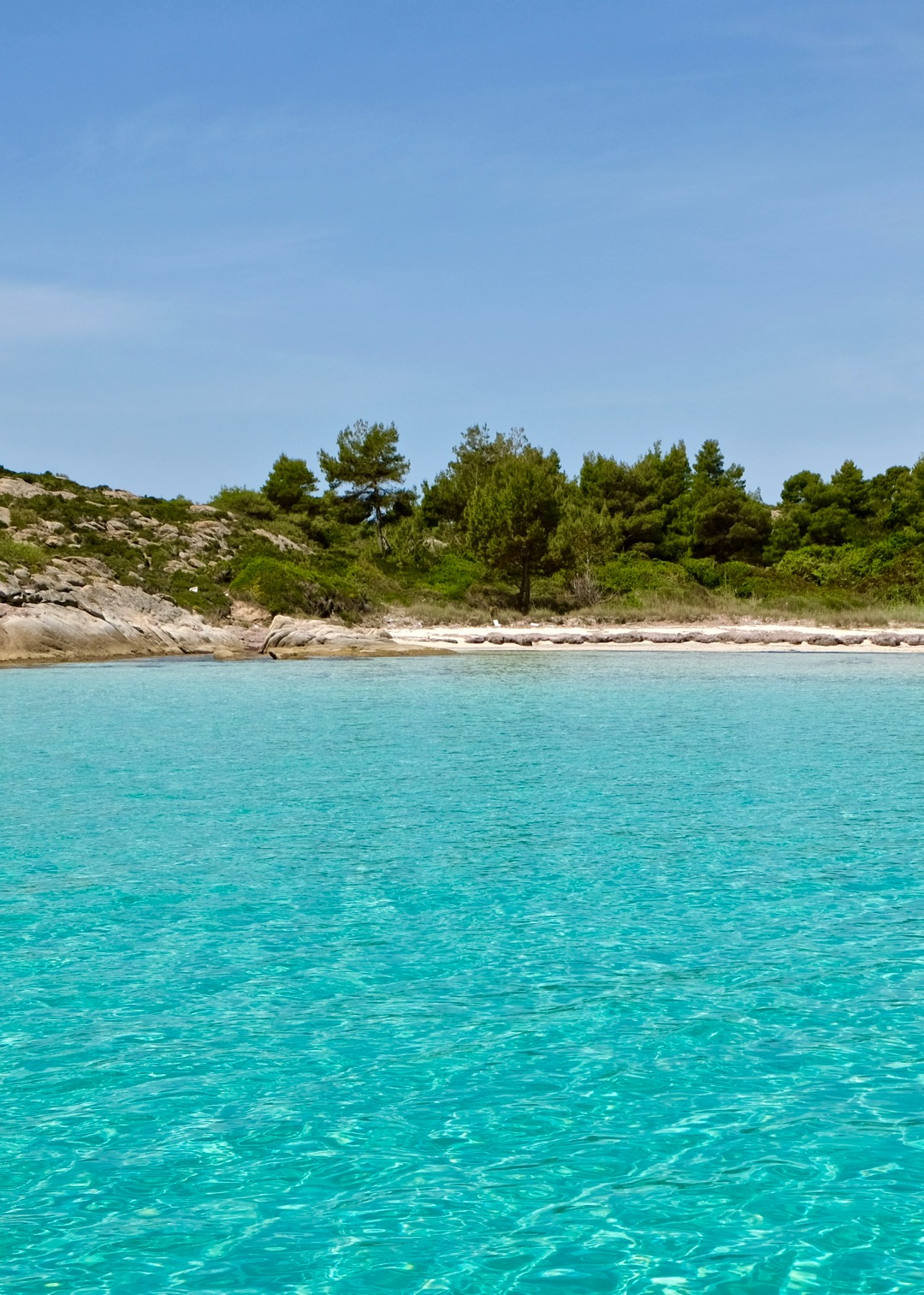 Myrsini Bay at Diaporos Island, Sithonia, Greece