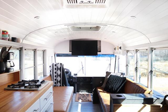 Interior facing the front of the bus.