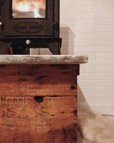 Zinc plated wood stove stand.