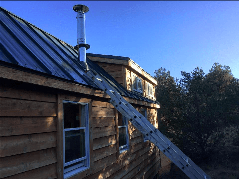Roof Exit Chimney Installation on a Tiny House