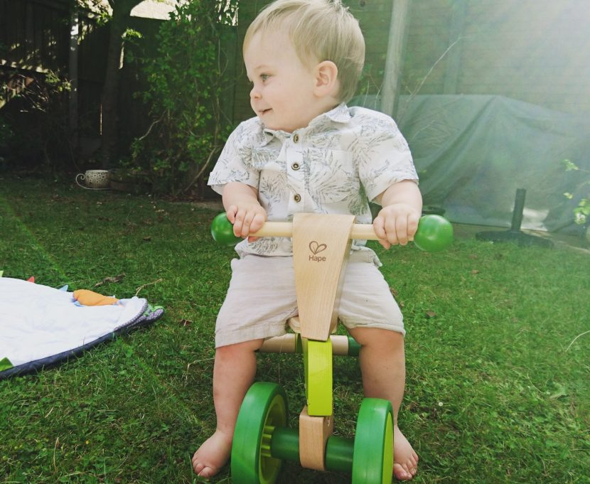 Hape Scoot Around - wooden rider - in use by him