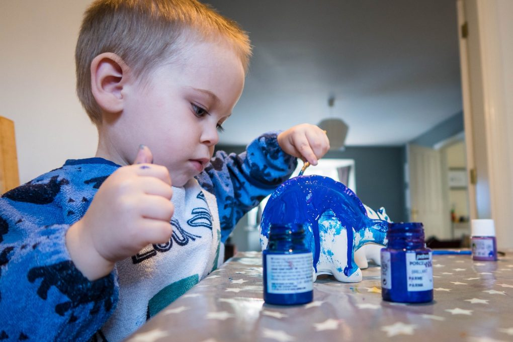 Dinosaur Crafts - painting our dinosaur money banks