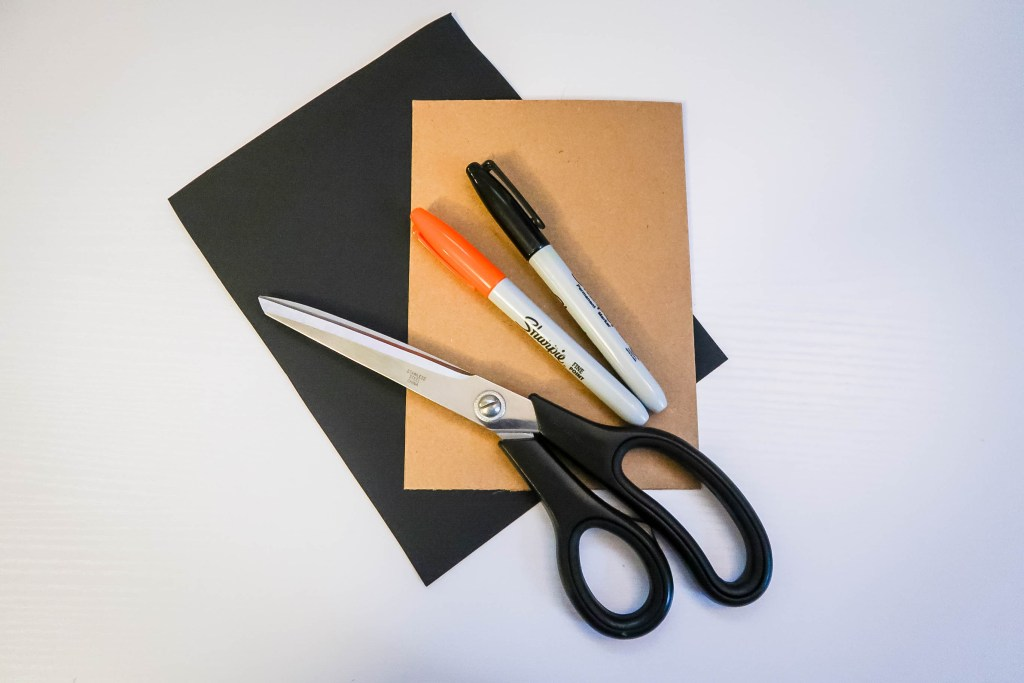 what you need  for your snowman cards - step two: scissors | double sided sticky tape  | scrap black & brown paper | black and orange pens