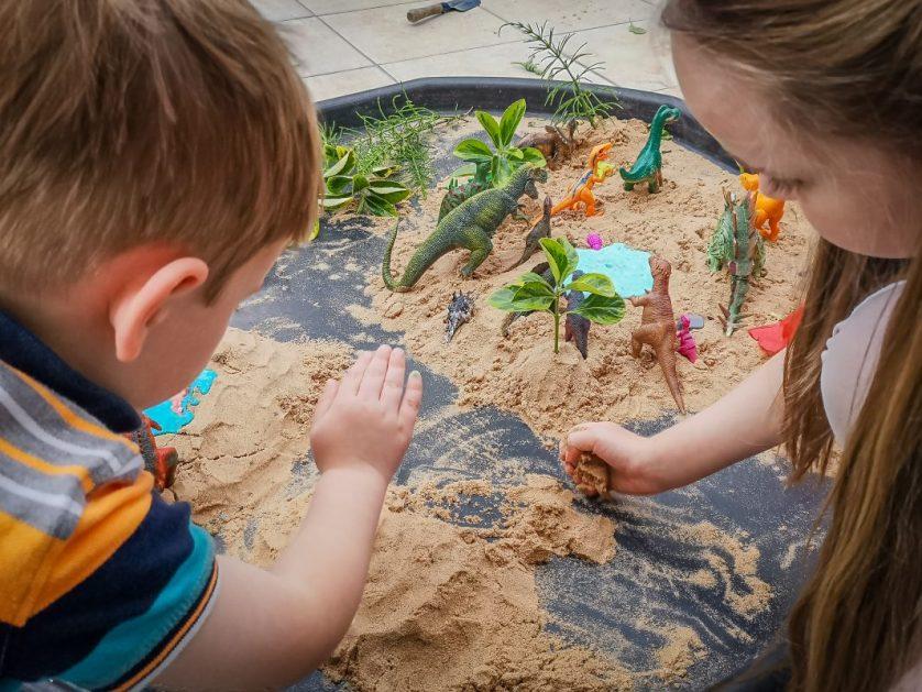 Tuff Tray Ideas: sand and slime dinosaur world