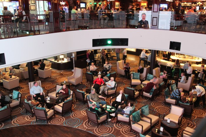 Norwegian Getaway Cruise Ship Atrium where the Guest Services, Excursions Desk, Cyber Cafe, Video wall and Atrium Cafe and Bar are located