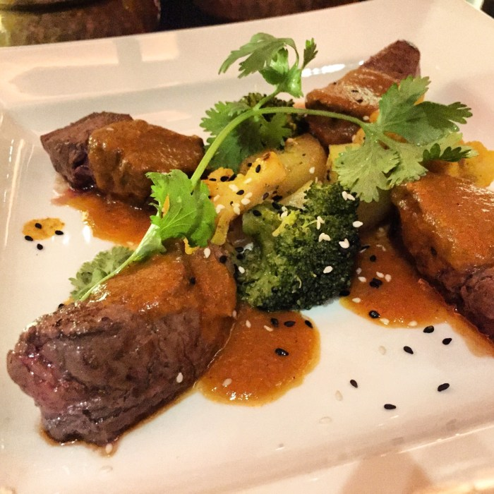 Sindu Laal Maas (Pan roast Beef Tenderloin with red masala sauce, sesame cauliflower and spiced new potato)