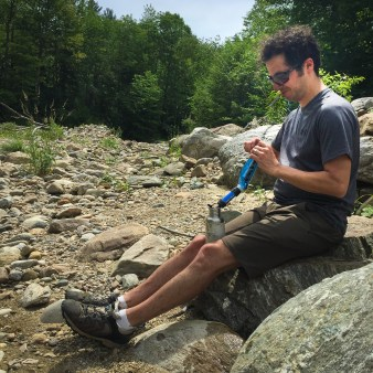 Jonathan filtering water with his Sawyer Mini alongside Middlebury Creek. This spot is just after a bridge near the junction of VT 125 and makes a good spot for quick resupply if needed.