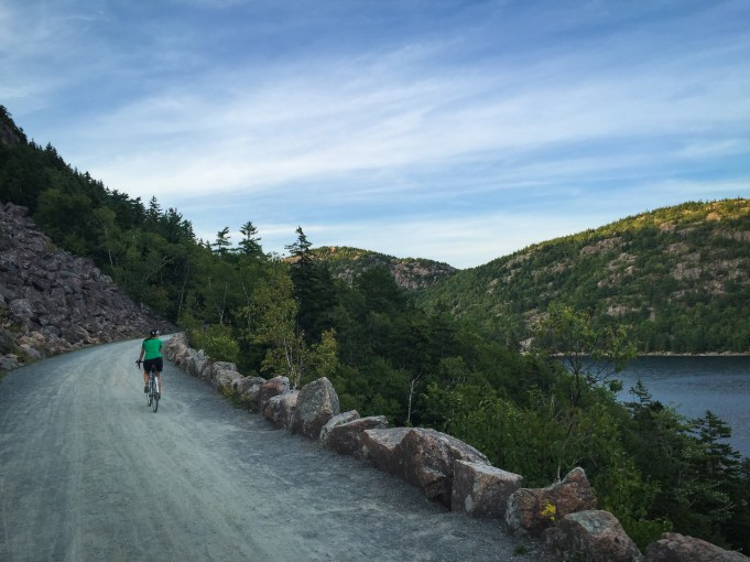 Nancy riding past Jordan Pond on one of the most picturesque bits of gravel road I've seen.