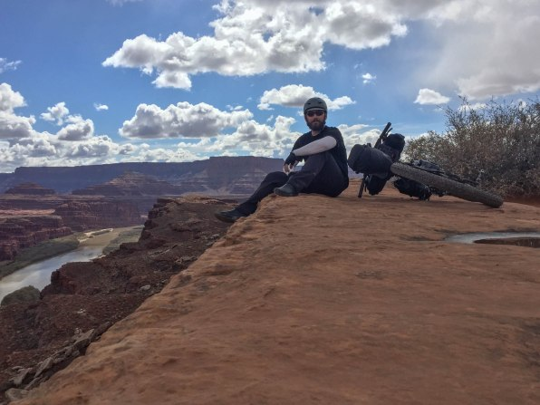 Yours truly with feet hanging off a long drop down to the mighty Colorado River at the Walking Rocks overlook.