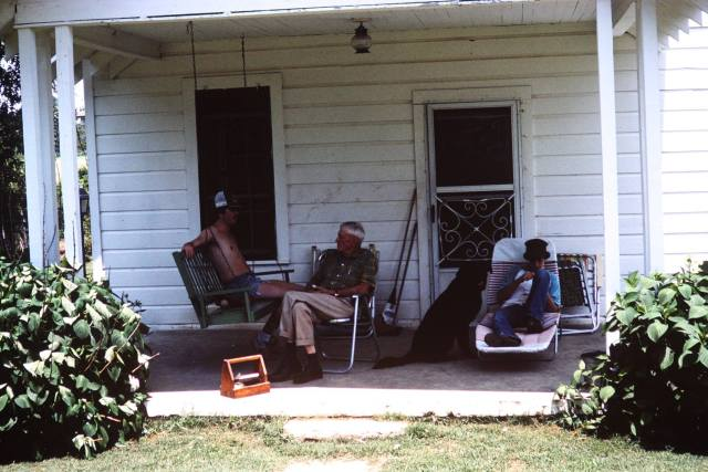 Roy E Faulk Sr More from Granddaddy's porch. Rodney on the swing, Squirt beside Danny and Roy E Faulk Sr in the middle. I know what Granddaddy had just done, the wooden box at his feet, he kept his shoe and boot polish in that, so he had polished his boots. Take care of things and they will last a long time