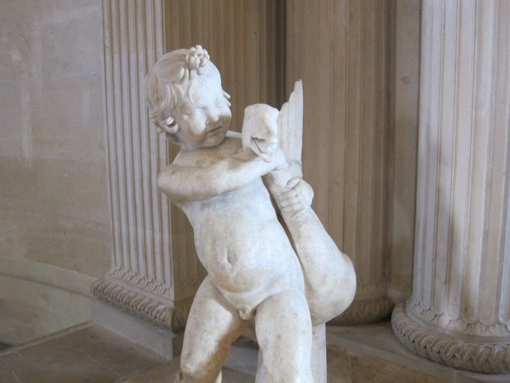 An ancient Roman statue of a boy strangling a goose.