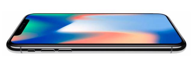 En la foto un móvil iPhone X tumbado mostrando un bonito degradado de color en su pantalla