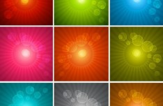 Set Of Glowing Halos and Radial Lights Background Vector