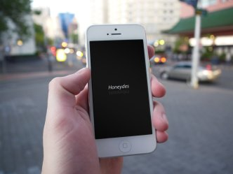 White iPhone 5S In Hand PSD