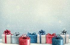 Christmas Gifts with Snowfall Background Vector