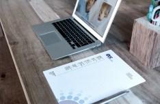 Mac Book & Letterhead On Desk Mockup