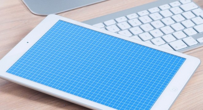 Photo Realistic iPad On Desk Mockup PSD
