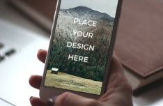 Photographic iPhone 6 In Hand Mockup PSD