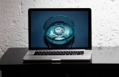 MacBook Pro On Desk PSD Mockup-min