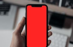 Man Holding An iPhone X XS PSD Mockup