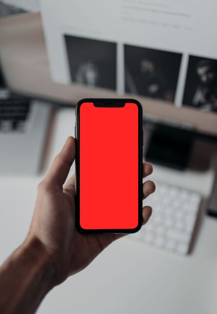 Man Holding An iPhone X XS PSD Mockup