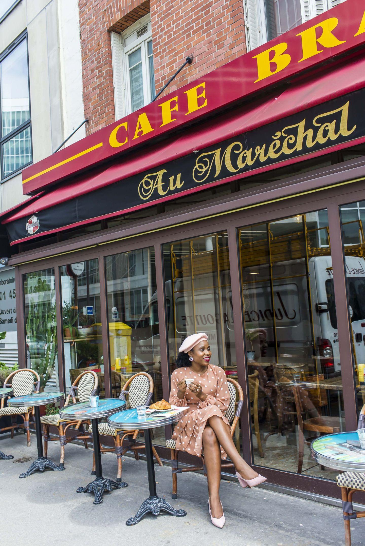 woman in polka dot dress at cafe