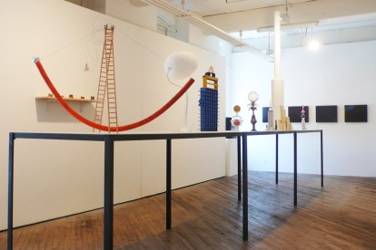 Installation view. In foreground: Erica Prince, Megastructure Models, 2012images selected by and courtesy of Vox Populi