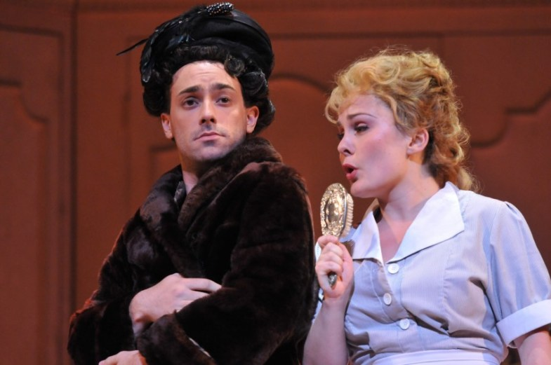 Ashley Emerson as the Chambermaid and Christopher Tiesi as the Electrician (wearing the Duchess's fur coat as he mocks her) in the first scene from Opera Philadelphia's new production of POWDER HER FACE Photo by Kelly & Massa