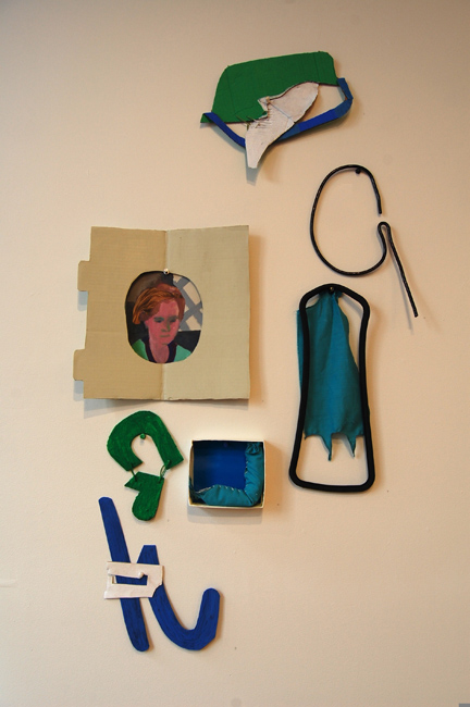 Bettina Nelson: I Forget Everything I Learned acrylic, gouache, tape, cardboard; Self Portrait, cardboard, paper, acrylic, gouache; Wire Portrait aluminum wire, oil paint pen; Green Letter Shape, cardboard, thread, acrylic, gouache; Perhaps a Caterpillar cardboard, paper, fabric, down feathers, acrylic, thread; Batman, found fabric, rubber; Blue Letter Shape, found paper, acrylic, gouache