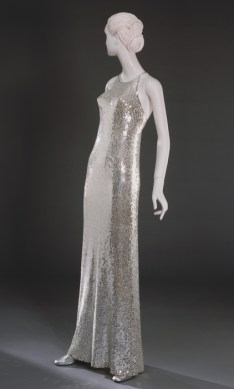 """Woman's """"Mermaid"""" Evening Dress, designed by Norman Norell, Sold by Nan Duskin, Philadelphia American, c. 1960, Metallicized plastic sequins on silk knit, Center Back Length: 60 inches (152.4 cm) Circumference (Bust): 32 inches (81.3 cm), Waist: 28 inches (71.1 cm), bequest of Ellen Biedlingmaier, 1975"""