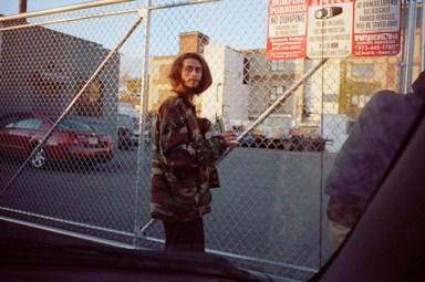 """Phil Jackson,Pat at the gates, Newark NJ, 2013. 12x18"""" chromogenic color print."""