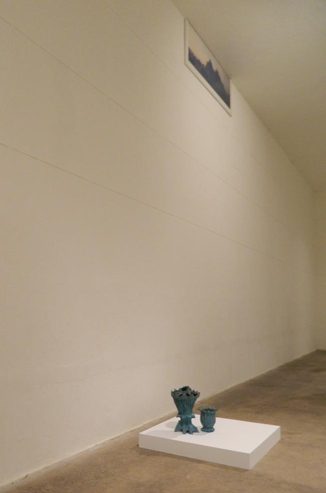 bottom to top: Paul Swenbeck, Untitled, 2014, ceramic / Eileen Neff, Twin Peaks, 2012, c-print mounted on plexi