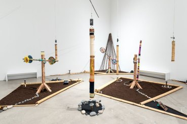 "Douglas R. Ewart, George Lewis, Douglas Repetto, Rio Negro II, 2007/2015. Interactive ""robotic-acoustic"" sound installation (rain sticks, chimes, bamboo, earth, wood, robotics, sculptures, and sound files). Dimensions variable. Installation view, The Freedom Principle: Experiments in Art and Music, 1965 to Now, Institute of Contemporary Art, University of Pennsylvania. Photo: Constance Mensh."